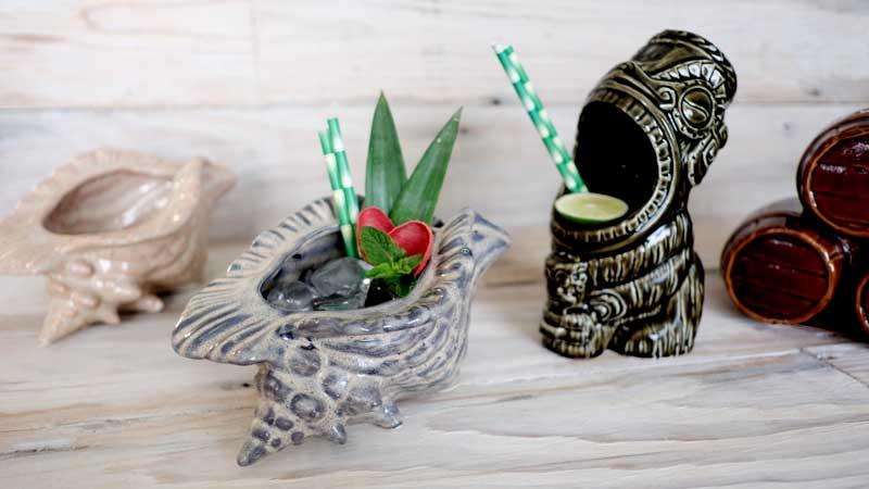 Ceramic Tiki mugs styled as drinks using paper straws