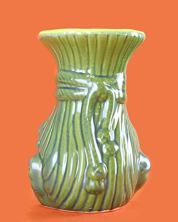 Ceramic shrunken head tiki mug green