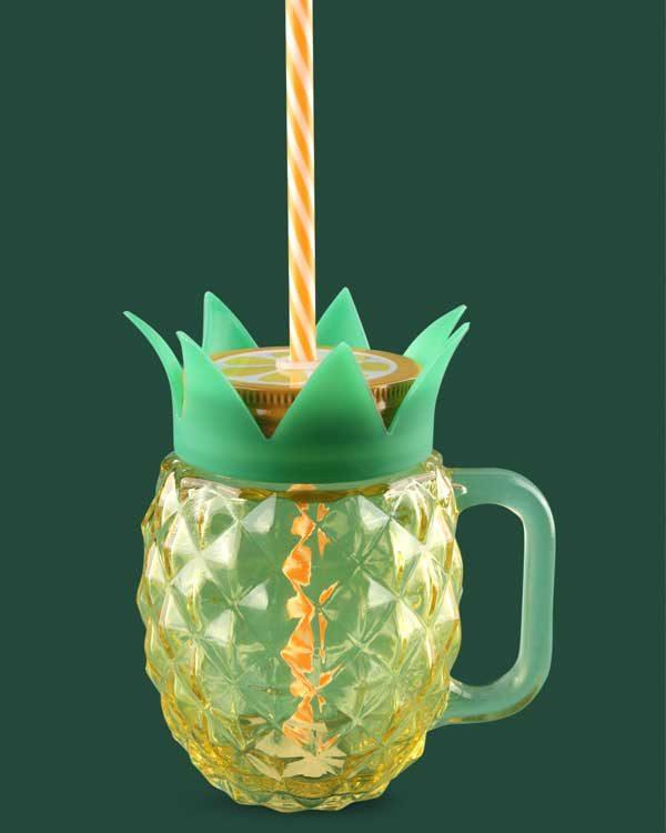 Mason glass with straw shaped like a pineapple
