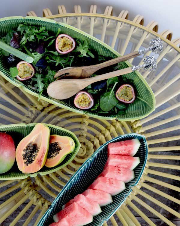 Ceramic leaf salad bowls on a rattan coffee table