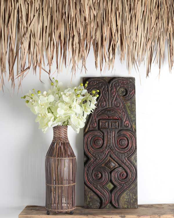 Artificial Orchid Stem with polynesian carving and tropical palm leaf thatch