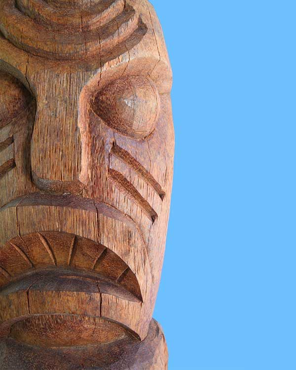 Hand carved wooden Tiki cannibal design