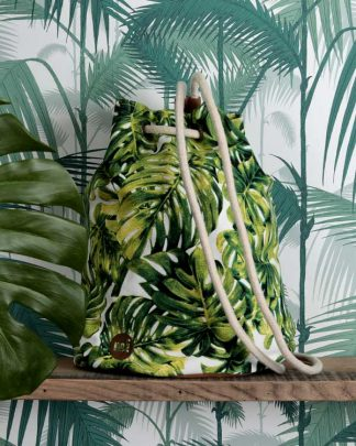Tropical palm print back pack against tropical wall paper