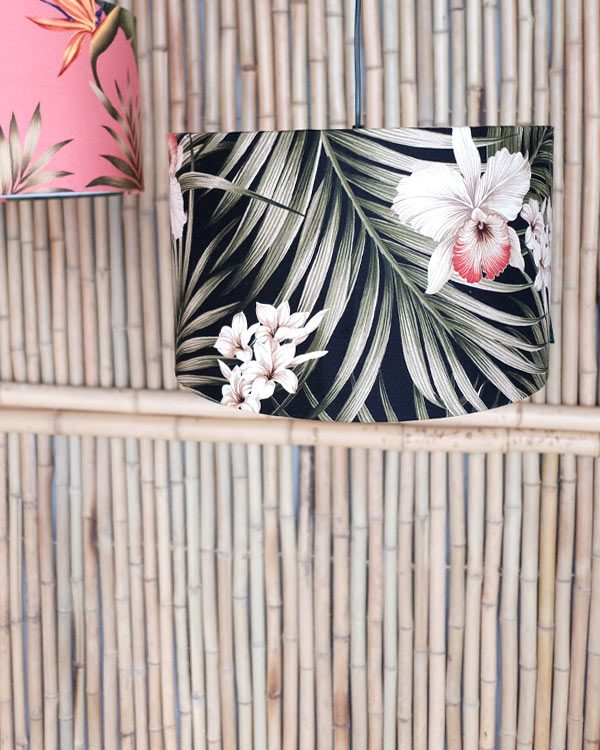 Tropical fern print lampshade on bamboo background