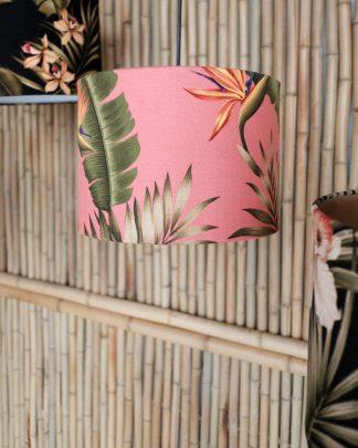 tropical print lampshade against bamboo wall