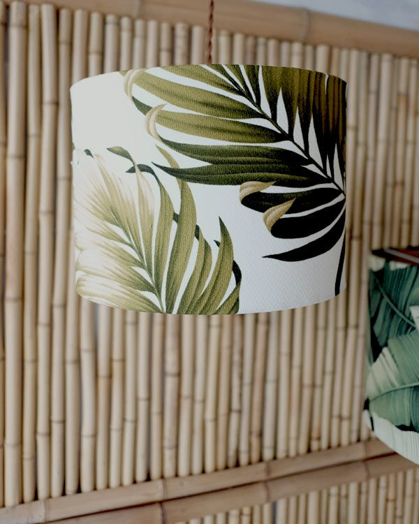 Tropical leaf print lampshade against bamboo background