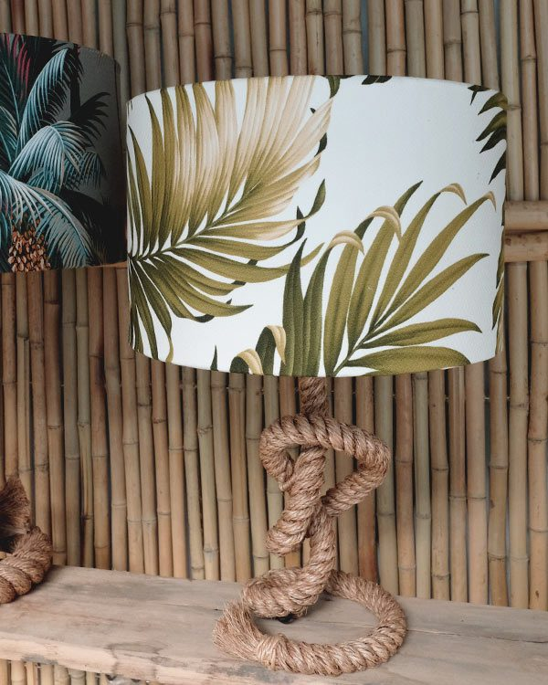 tropical palm print table lampshade drum against bamboo wall