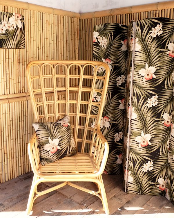 Room setting with tropical printed room divider, chair, tropical print cushion and tropical print lamshade
