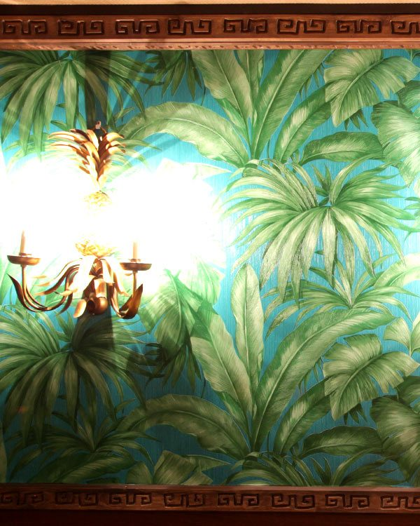 TROPICAL LEAVES WALL PAPER WITH GOLD PINEAPPLE WALL LIGHT